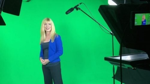 virtual public speaking training - lisa in front of green screen